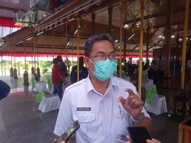 Humas Satgas Covid-19 Kabupaten Bangkalan Saat Diwawancarai (Foto : Pojoksuramadu.com)